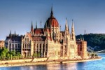 I took many shots of the Hungarian parliament while walking on the opposite shore of the Danube. It was a nice lazy sunny summer afternoon. Processed the shot to enhance the lazy afternoon mood.